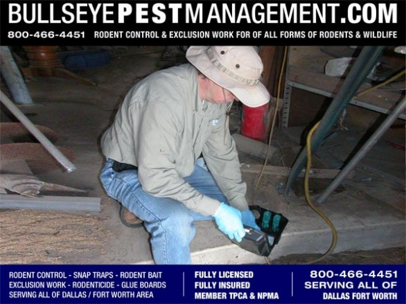 Bullseye Pest Management Independent Owner / Operator Steve Moseley prepares a rodenticide bait station in a warehouse in Waxahachie, Texas.